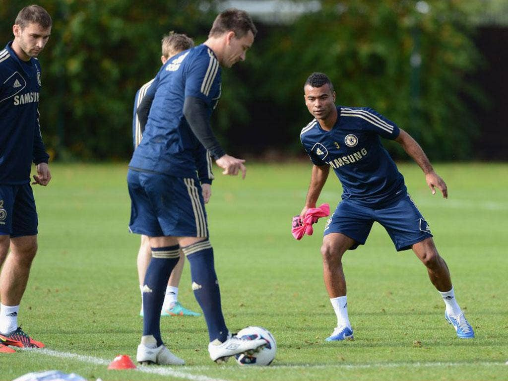 Ashley Cole (right) and John Terry train at Cobham yesterday