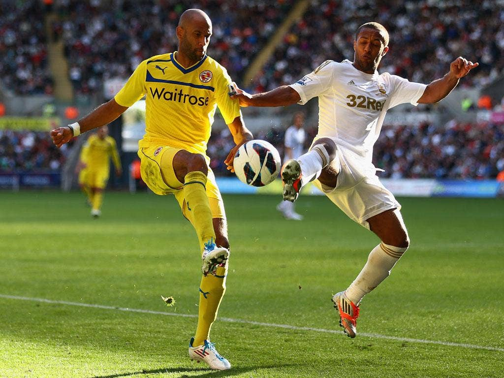 <b>Swansea 2-2 Reading</b> Jimmy Kebe of Reading battles for the ball with Wayne Routledge of Swansea City