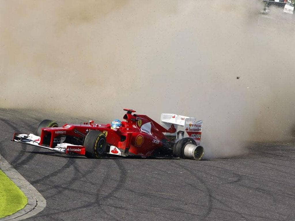 Fernando Alonso spins off on the first corner of the Japanese Grand Prix