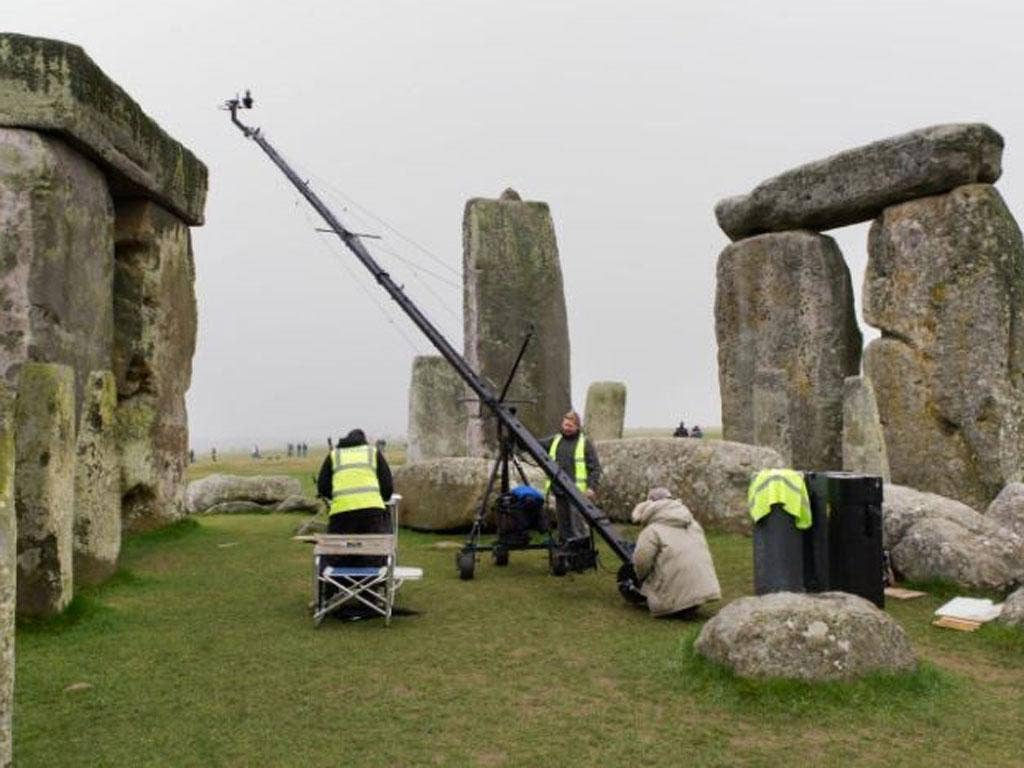 Surveyors carry out the laser-scans of the Stonehenge monuments, which revealed 72 images of Stone Age 'artwork'