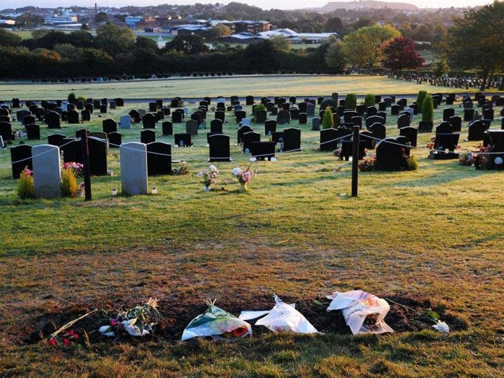 Flowers lay in place of Sir Jimmy Savile's gravestone at Woodlands Cemetery in Scarborough this morning
