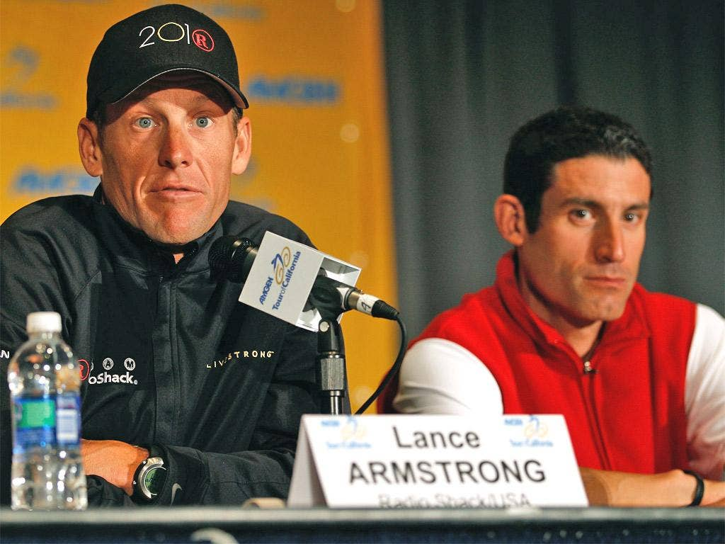 Armstrong and Hincapie sit together at a press conference in 2010