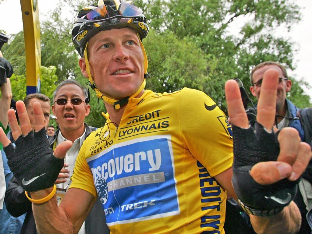Lance Armstrong celebrates his seventh Tour de France win
