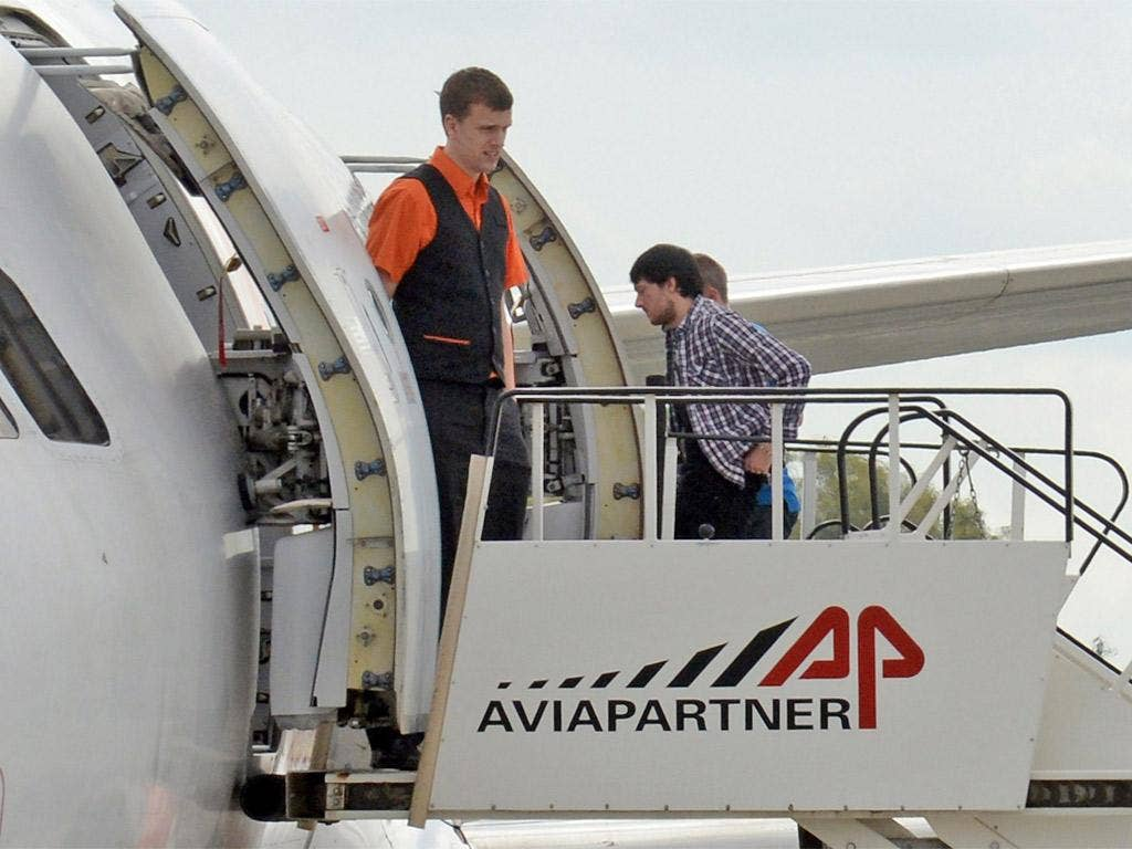 Jeremy Forrest boards an aeroplane as he is extradited to Britain