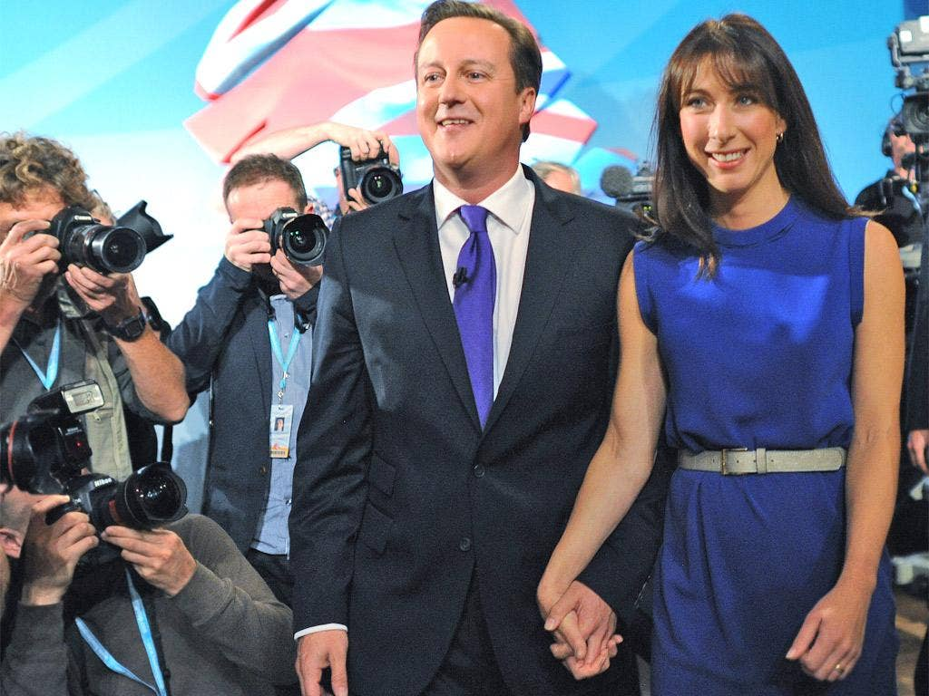 David Cameron and wife Samantha are pictured following his speech