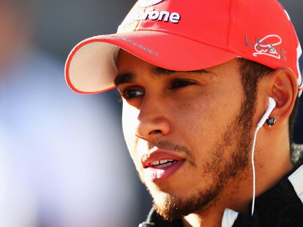 McLaren driver Lewis Hamilton was forced to apologise to his team-mate Jenson Button after wrongfully accusing his compatriot of 'unfollowing' him on Twitter.