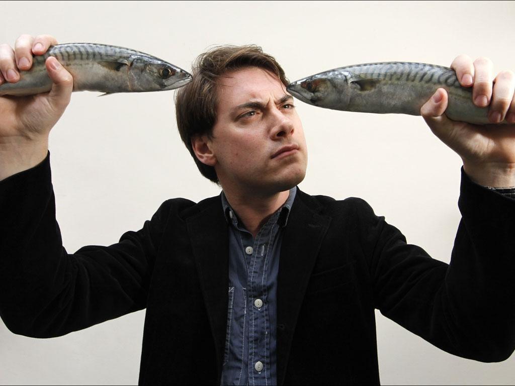 Sink or swim: writer Jamie Merrill with two line-caught Cornish mackerel