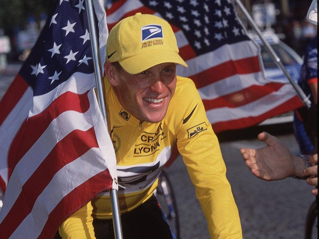 Lance Armstrong celebrates winning the 2001 Tour de France