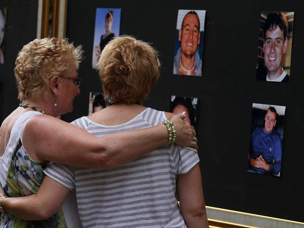 Relatives of victims of the 2002 bombings comfort one another