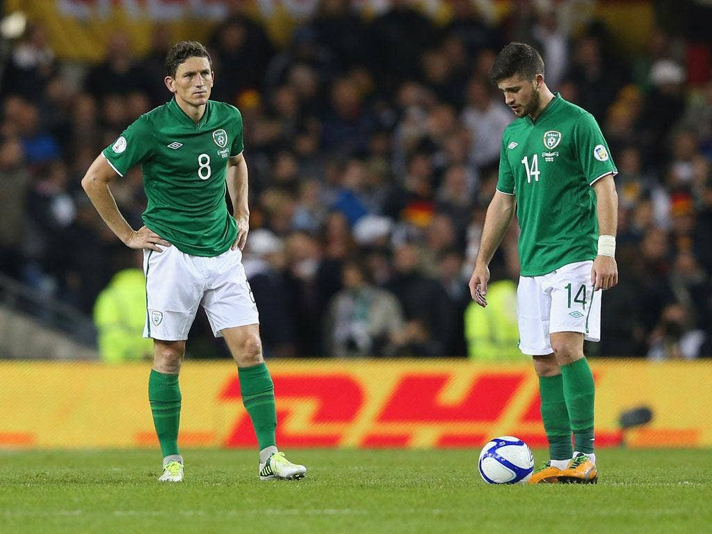 Keith Andrews and Shane Long of the Republic of Ireland look disheartened after Germany's sixth goal goes in