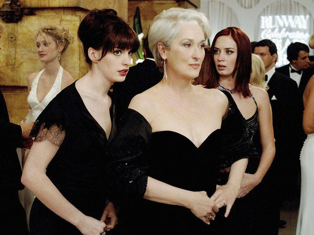 No mercy: Emily Blunt, far right, glares at her rival Anne Hathaway as she usurps her advisory role to Meryl Streep, centre, in 'The Devil Wears Prada'