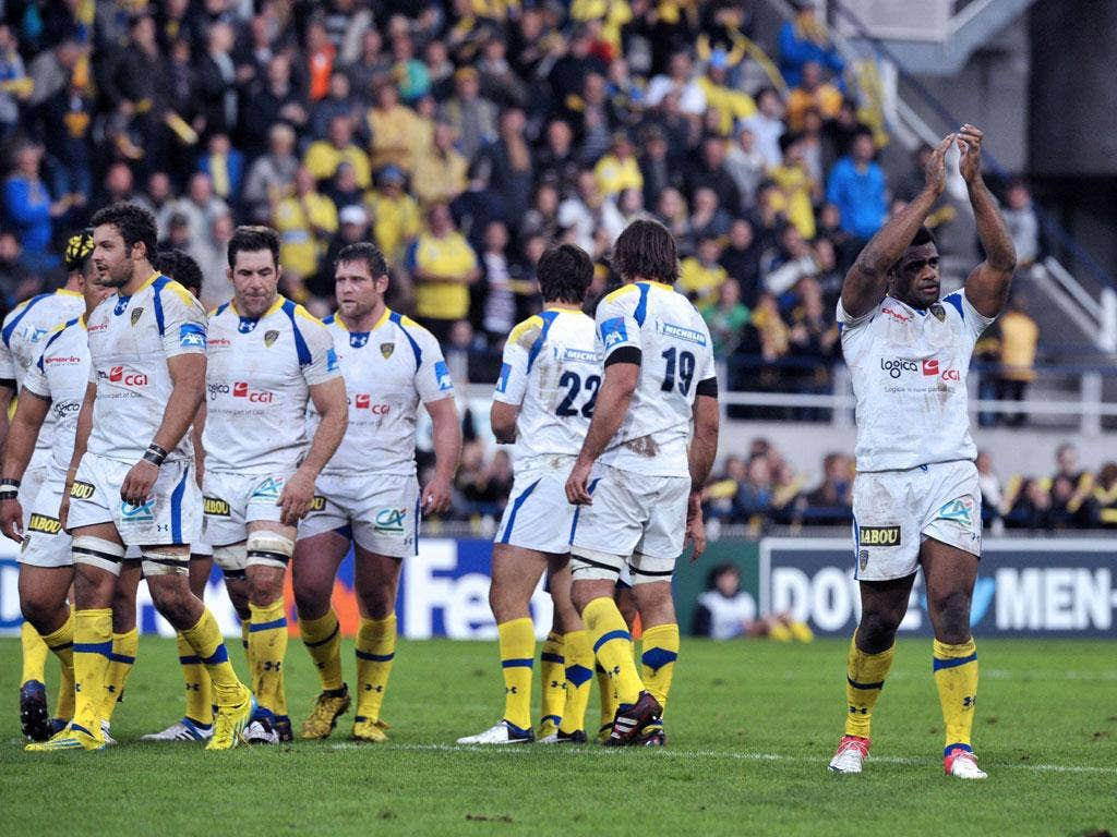 Clermont's Napolioni Nalaga (R) celebrates with teammates after the win