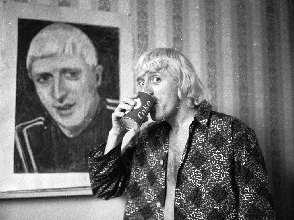 Savile in his Bloomsbury hotel room in 1965, in front of a portrait of himself