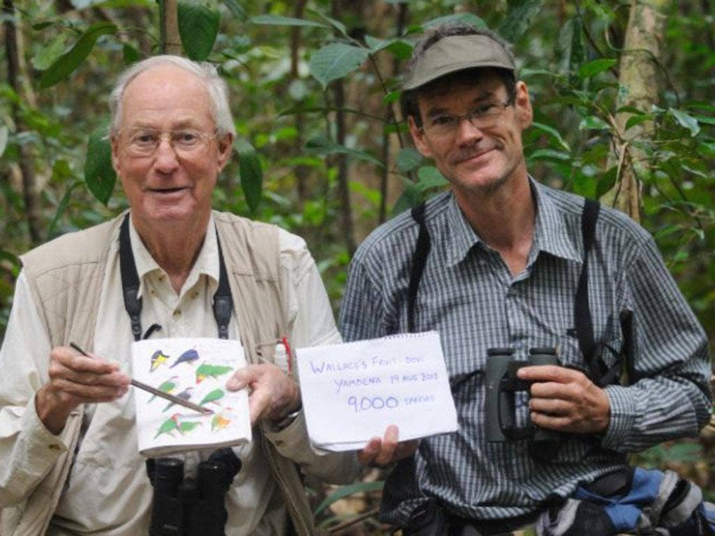 Tom Gullick, left, with bird guide Frank Lambert, after spotting the Wallace's fruit dove in Indonesia