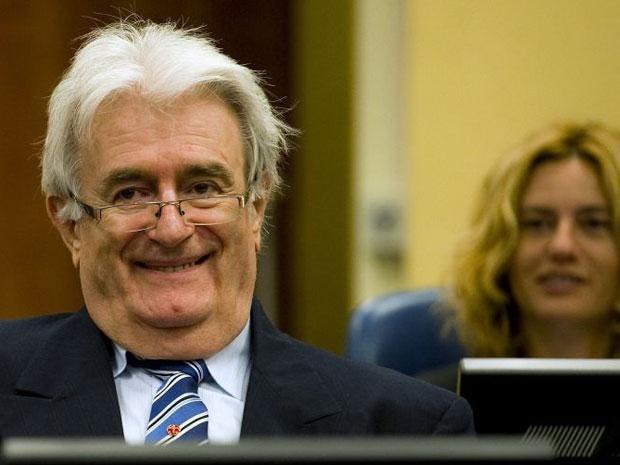 Radovan Karadzic smiles as he starts his defence at the UN war crimes tribunal