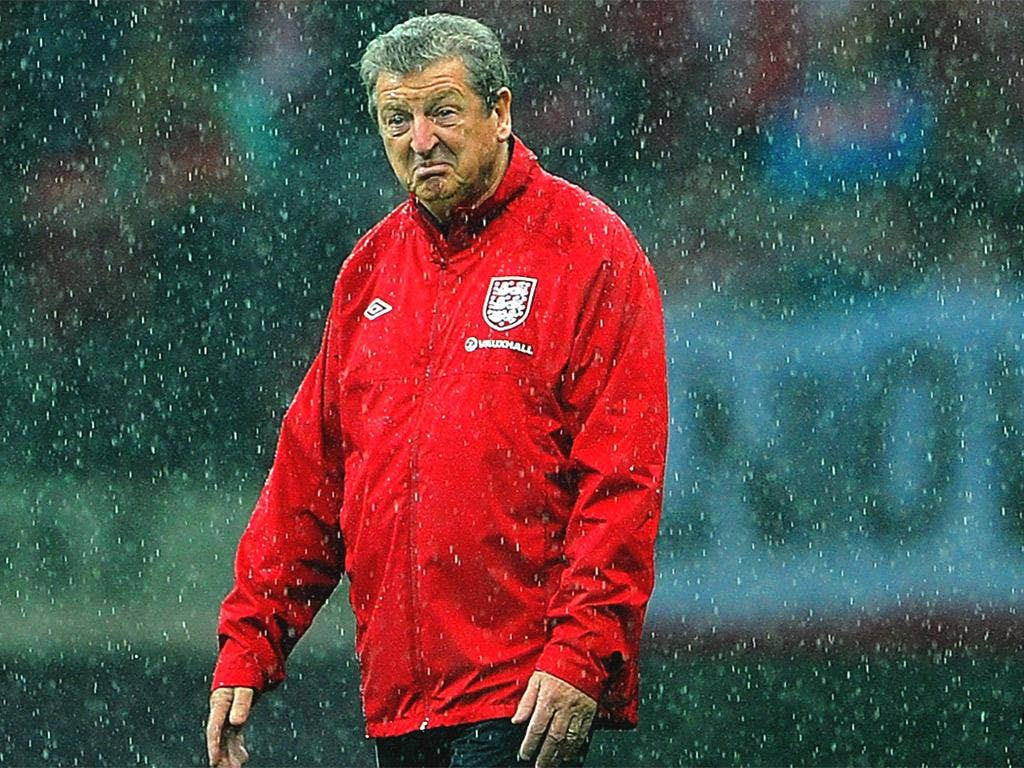 Roy Hodgson inspects the pitch at the National Stadium in Warsaw
