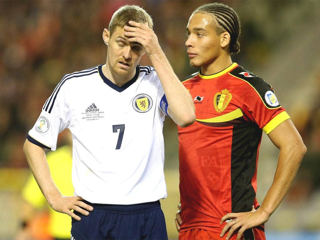 Darren Fletcher looks dejected as Scotland's qualification hopes took another blow