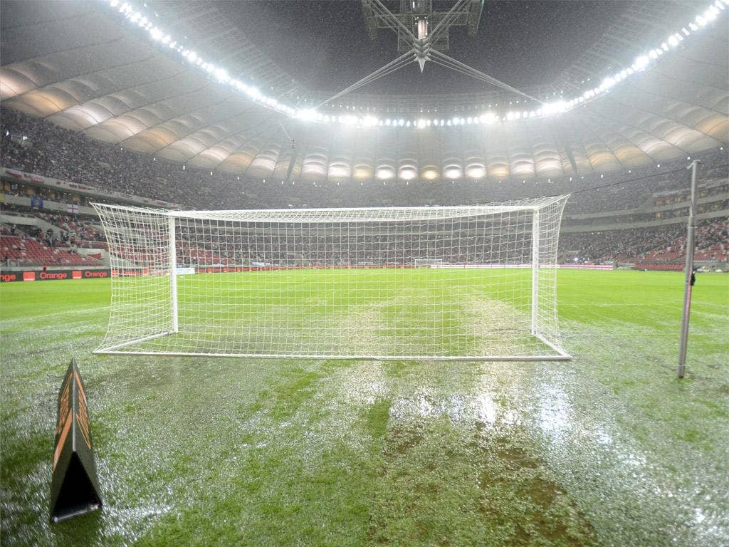 The puddle-ridden pitch at the National Stadium in Warsaw last night