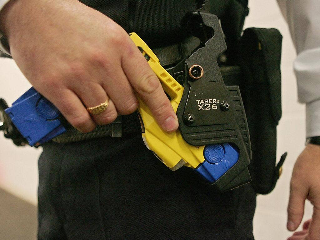 A police officer with a Taser weapon
