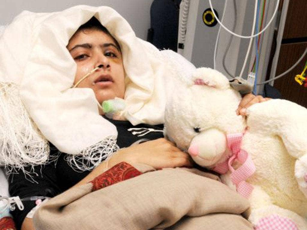 The Pakistani teenager Malala Yousafzai pictured in her Birmingham hospital bed