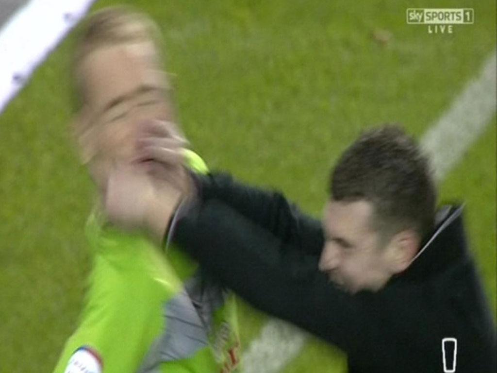 Sheffield Wednesday goalkeeper Chris Kirkland is attacked by a Leeds fan at Hillsborough last night