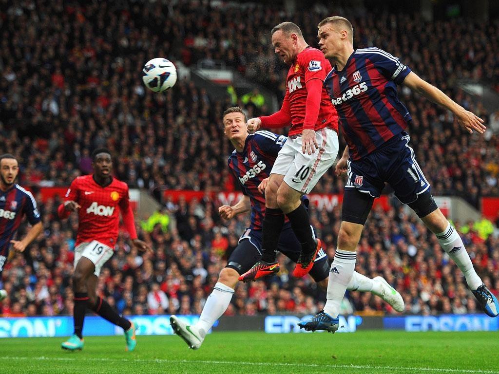 Wayne Rooney heading in United's equaliser against Stoke