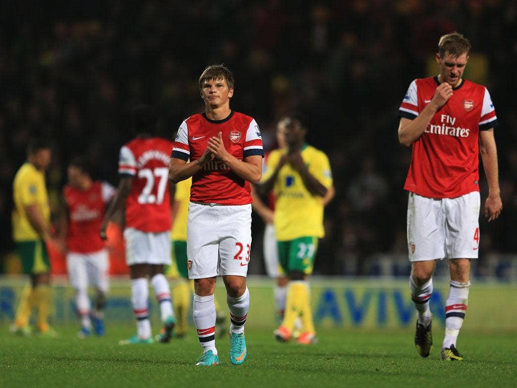 Andrey Arshavin and Per Mertesacker of Arsenal look dejected in defeat