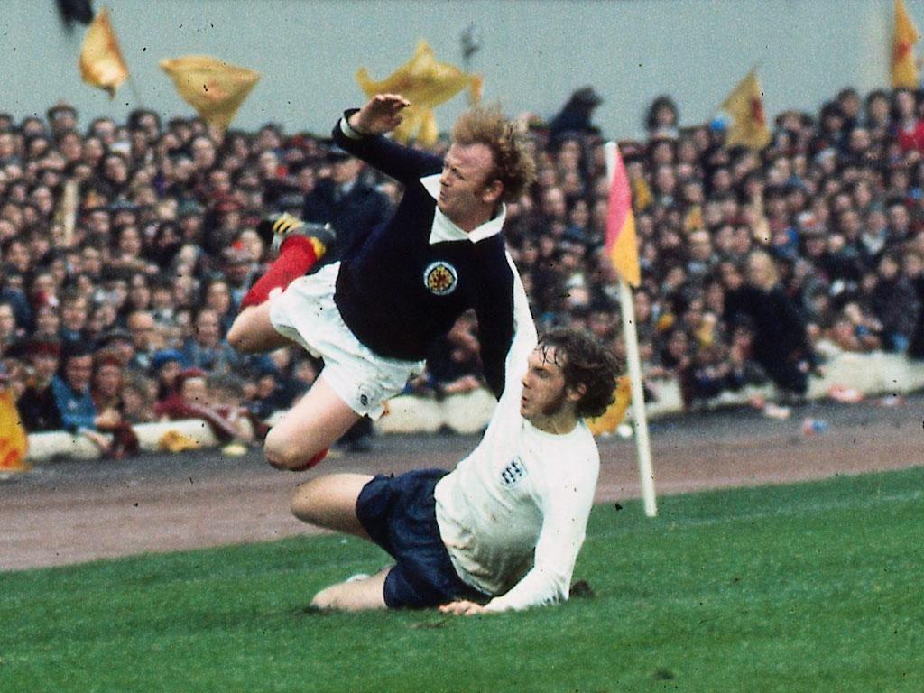 Flying Scotsman: Mike Pejic tackles Billy Bremner at Hampden in 1974
