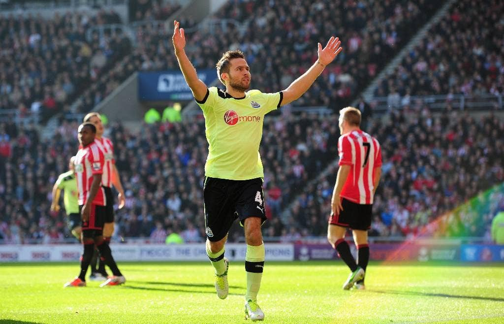 Newcastle player Yohan Cabaye celebrates the first goal
