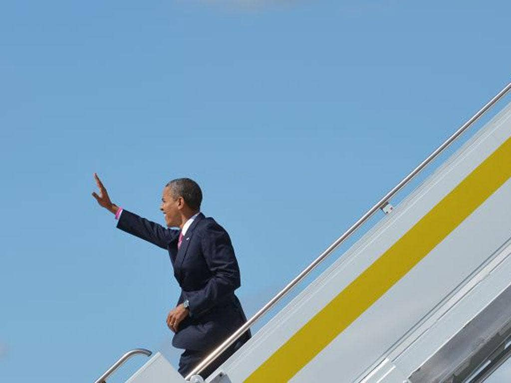 Barack Obama arrives in Florida yesterday ahead of last night's debate