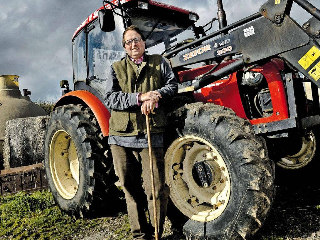 Still standing: Jan McCourt with his tractor