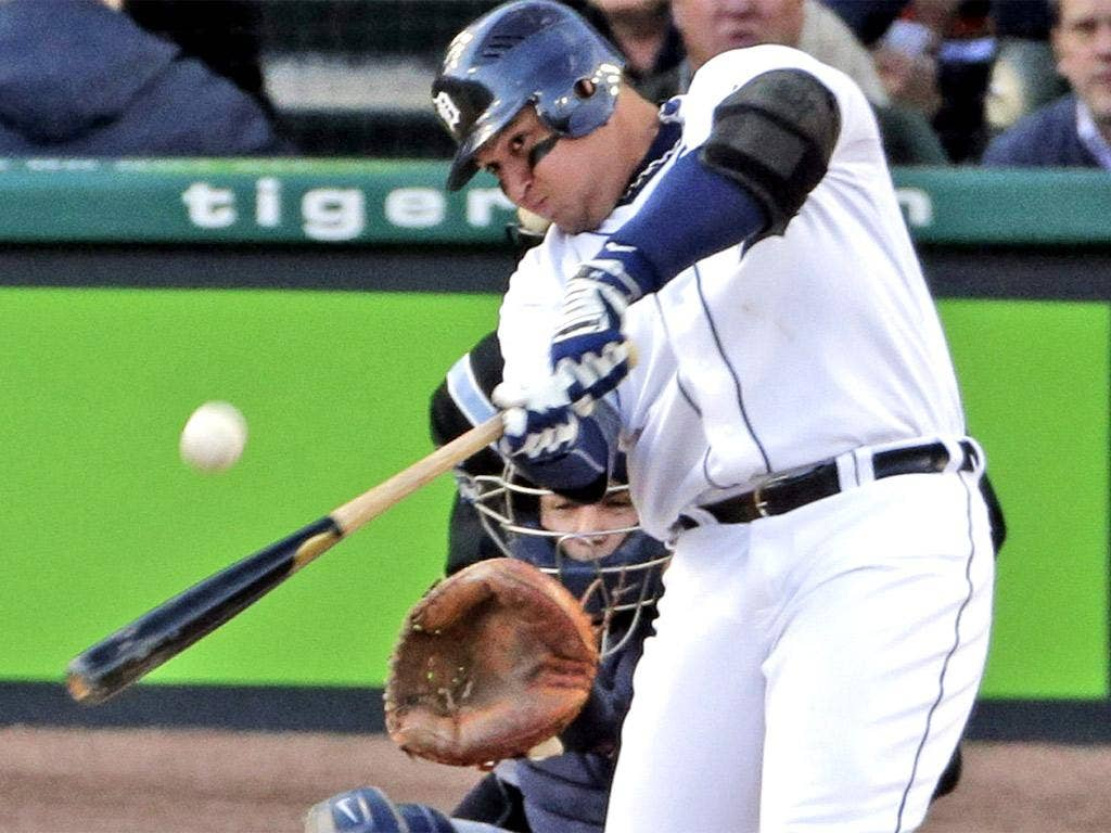 Tigers' Miguel Cabrera hits a home run against the Yankees