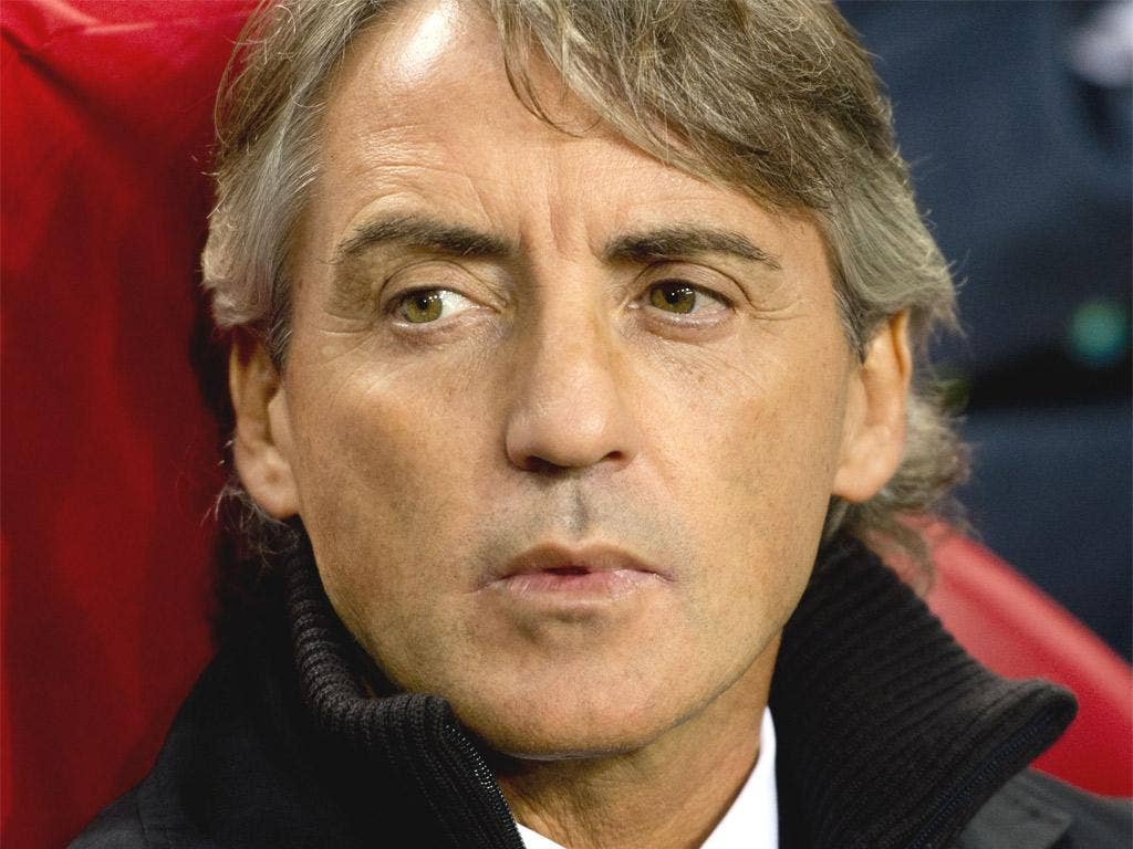 Roberto Mancini has yet to match the demands of Europe