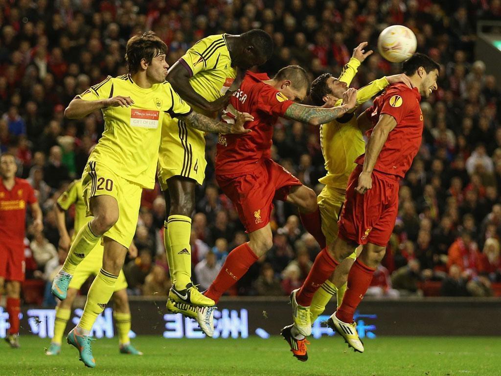 Daniel Agger and Luis Suarez, of Liverpool, put pressure on Anzhi last night