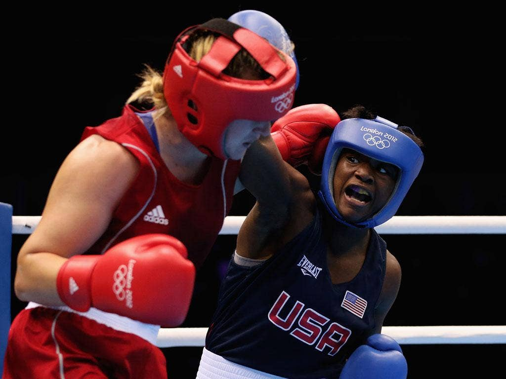 Marina Volnova of Kazakhstan and America's Claressa Shields compete in the Olympics
