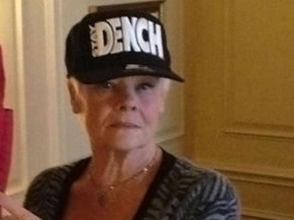 Judi Dench cemented her place in the lady dude hall of fame later in the week by getting a picture of herself on Twitter wearing a Dench cap
