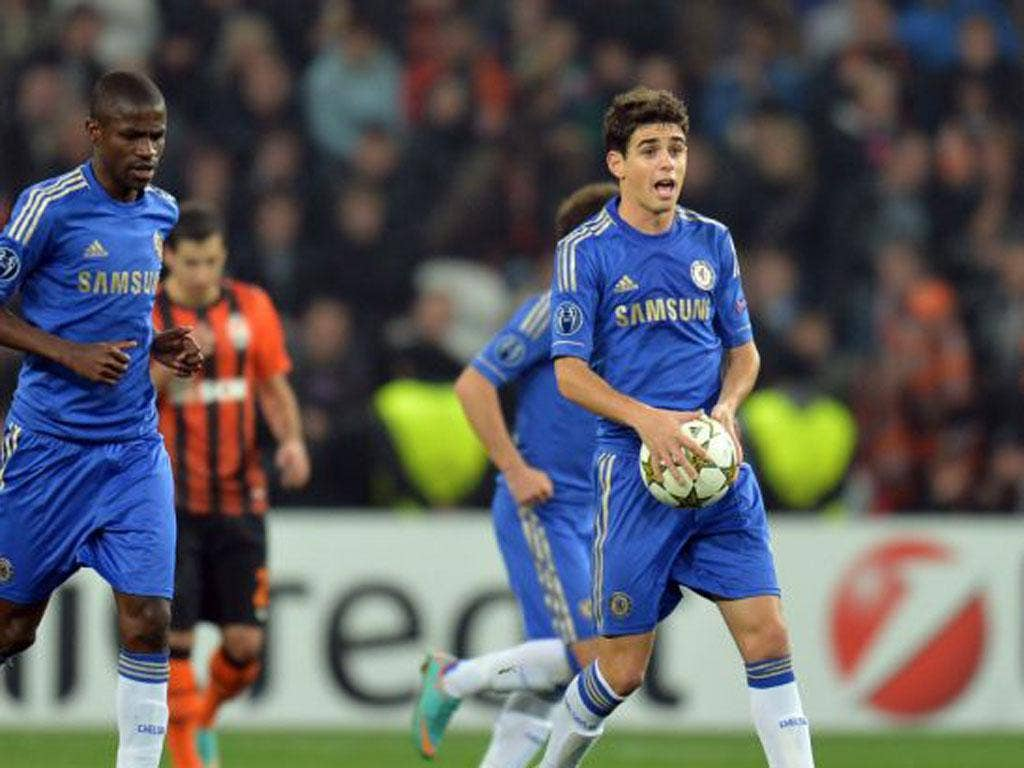 Oscar grabs the ball after scoring a consolation goal for Chelsea against Shakhtar Donetsk in the Champions League this week
