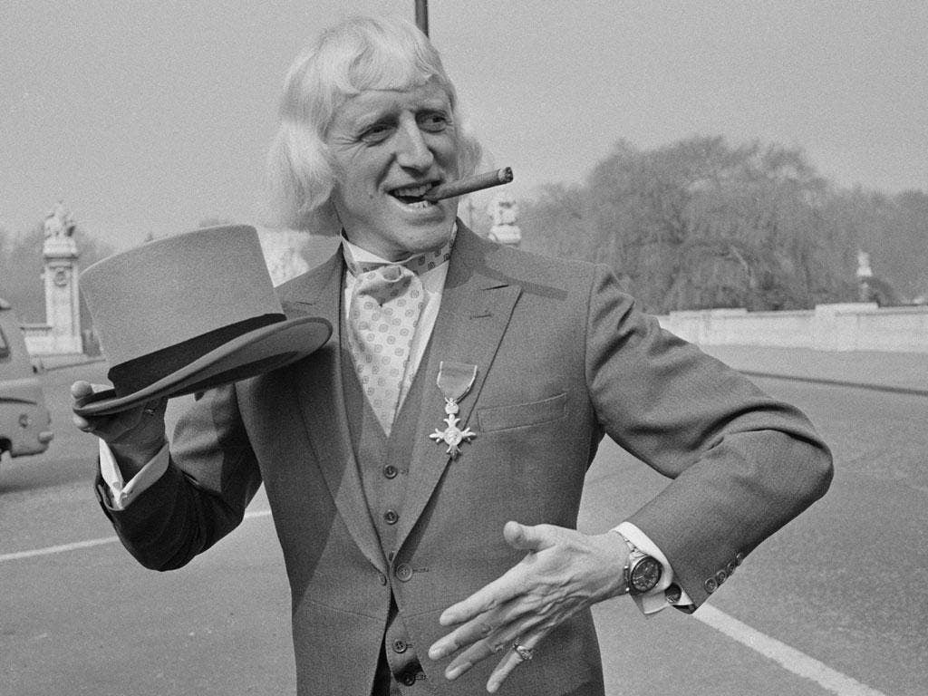 Hidden scandal: Jimmy Savile, when he was made OBE in 1972