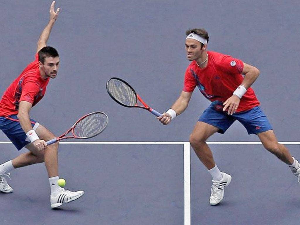 Ross Hutchins (right) and Colin Fleming in action in the Shanghai Rolex Masters