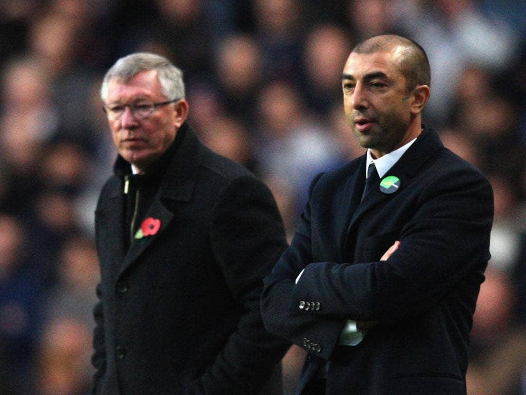 Managers Sir Alex Ferguson of Manchester United and Roberto di Matteo of Chelsea watch from the touchline