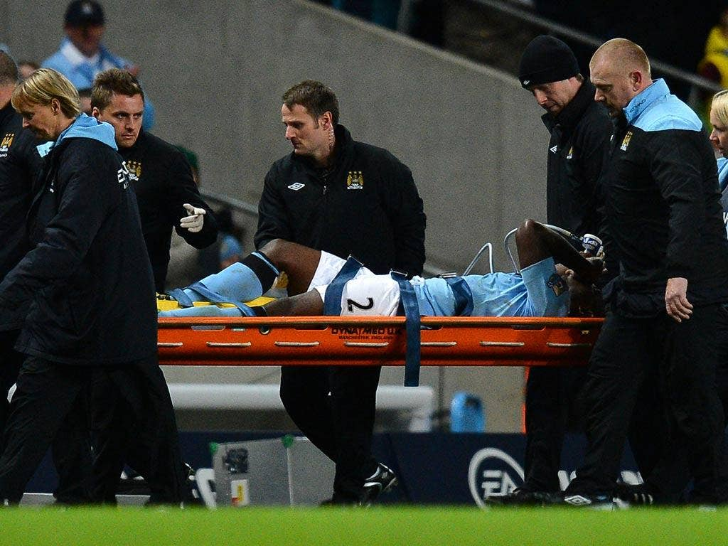 Micah Richards is taken off in the Premier League game against Swansea