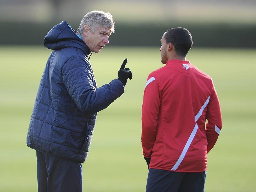 Theo Walcott takes instructions from Arsene Wenger