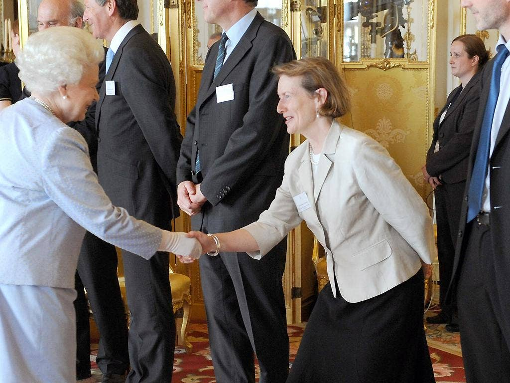 The Queen meets Dame Helen Ghosh at a reception for winners of the Queen's Awards for Enterprise at Buckingham Palace in 2010