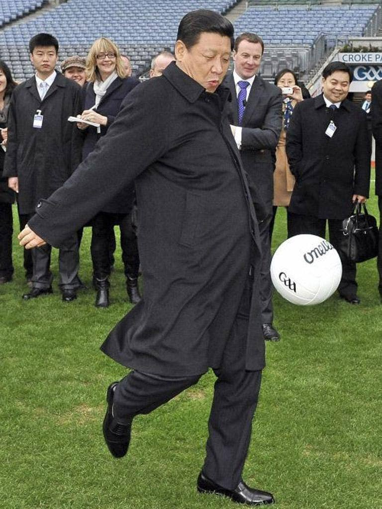 Xi Jinping kicks a football during visit to Croke Park Stadium in Dublin earlier this year
