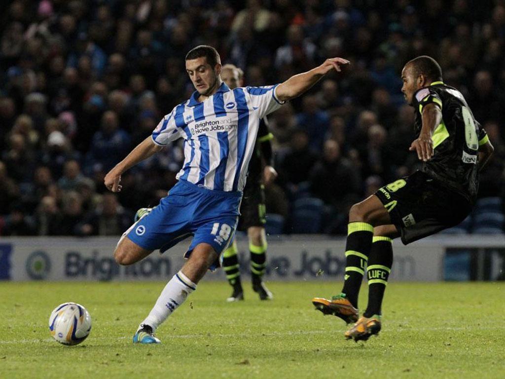 Gary Dicker of Brighton tries to shoot around Leeds midfielder Rodolph Austin