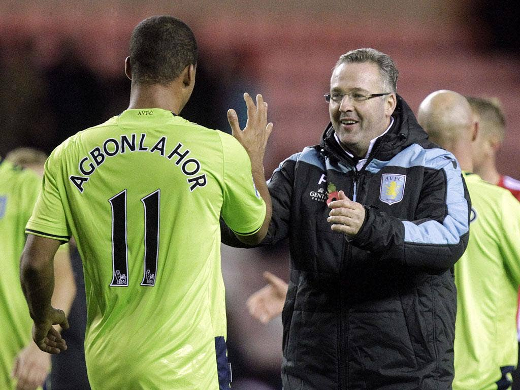 Agbonlahor celebrates with his manager, Paul Lambert