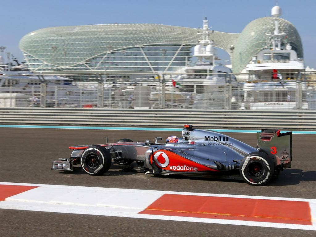 Eastern delight: McLaren's Jenson Button drives the Yas Marina Circuit in final qualifying for the Abu Dhabi Grand Prix