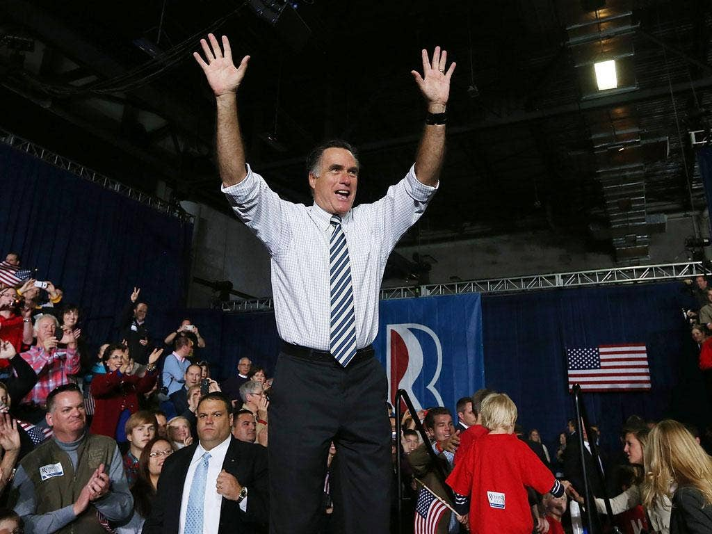 Republican presidential candidate, former Massachusetts Gov. Mitt Romney greets supporters during a campaign rally at the Hy Vee Center in Des Moines, Iowa