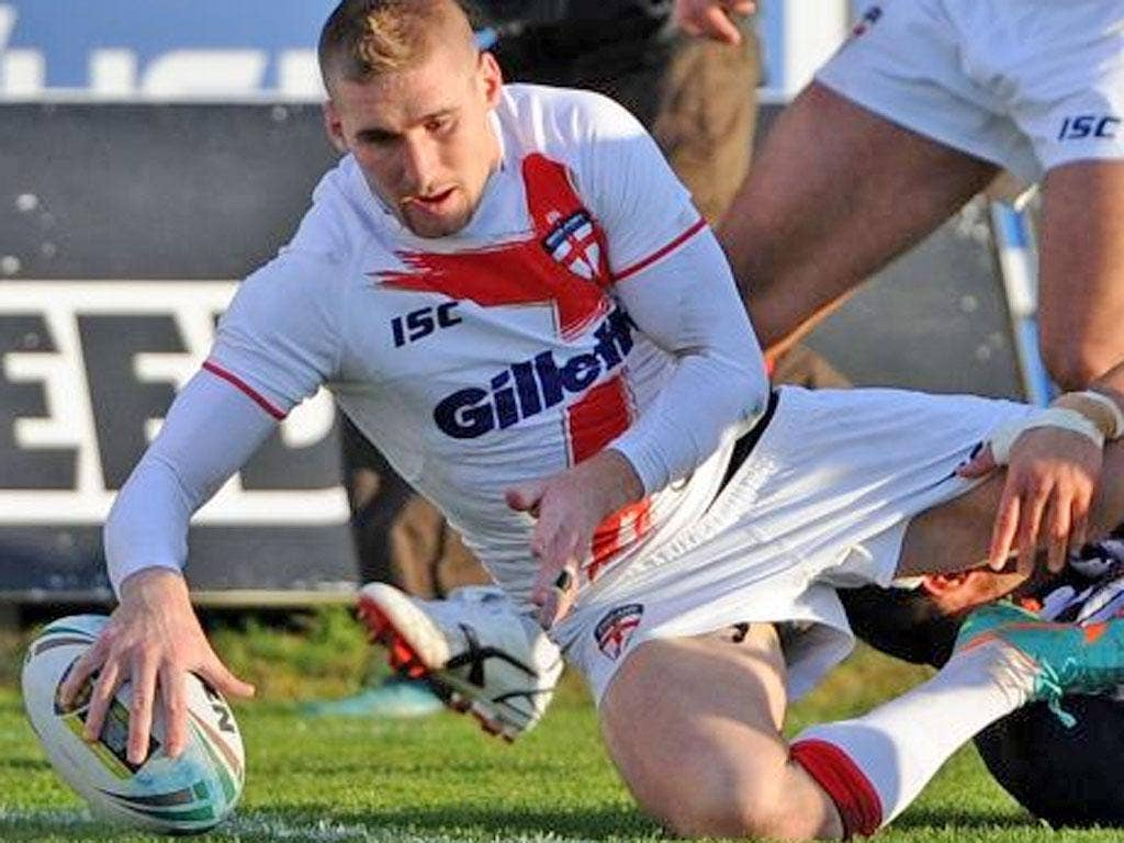 Sam Tomkins returned after a knee injury to score two tries in the 44-6 win over France on Saturday