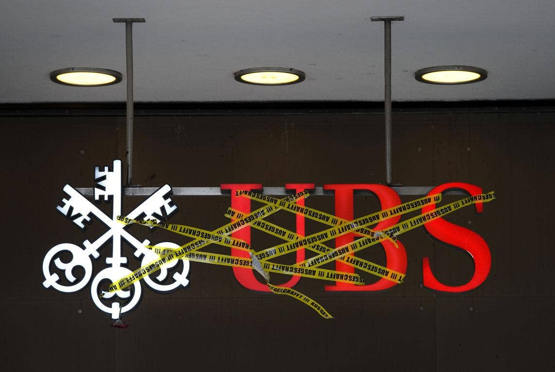 The logo of Swiss banking giant UBS is covered with tape, reading in German: 'Deported!!!' in Zurich on October 15, 2011 during a protest as part of a global day of protests inspired by the 'Occupy Wall Street' and 'Indignant' movements against the bankin